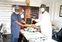 Chairman, Lagos State Polytechnic (LASPOTECH) Visitation Panel, Barr. Adelowo Afolayan (left) presenting the Visitation Panel report to Special Adviser to the Governor on Education, Mr. Tokunbo Wahab (right) on Thursday, June 25, 2020