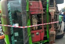 The container fell on a commercial bus killing two persons