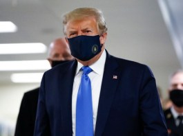 President Donald Trump wearing face mask for first time in public during a visit to Walter Reed hospital