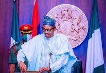 President Muhammadu Buhari carrying a bar of gold US visa ban