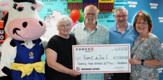 Tom, centre, and Joe (right) are pictured with their wives after scooping the Powerball jackpot