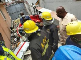 LASEMA officials at the scene of the helicopter crash in Opebi, Lagos state