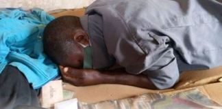 The late Solomon Ede lying face down with his face mask still on