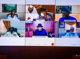 Vice President Yemi Osinbajo attends a virtual meeting with former Heads of State presided over by President Buhari at the Council Chambers in the State House, Abuja