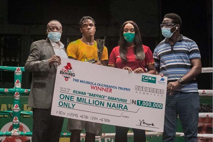 L-R; President of the Nigerian Boxing Board of Control (NBB of C), Mr. Rafiu Ladipo; Best Boxer GOtv Boxing Night 21, Rilwan