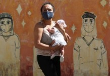 argentina- woman carrying baby