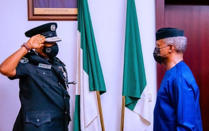 Vice President Yemi Osinbajo SAN decorates the new Acting Inspector General of the Nigerian Police Force Usman Alkali Baba at the State House, Abuja. 7th April, 2020. Photos; Tolani Alli