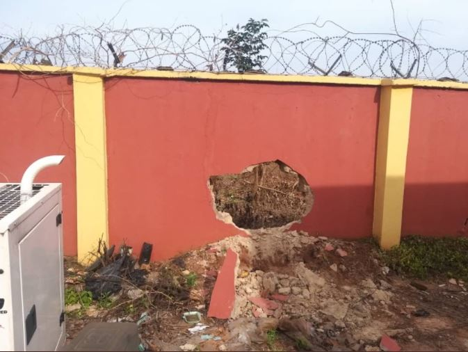 Damaged section of the perimeter fence blown open by the attackers to gain access into INEC office in Anambra State