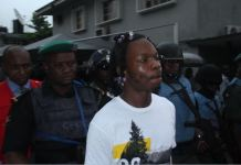 Naira Marley was charged for online fraud and his laptop was confiscated