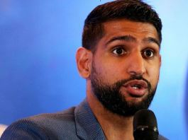 British boxer Amir Khan was thrown out of an American Airlines flight over masking requirement