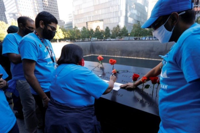 Family members of Jayesh Shah make a rubbing of his name at the 9-11 Memorial on the 20th anniversary of the September 11 attacks in Manhattan, New York City, U.S., September 11, 2021