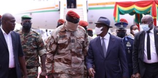 Ivory Coast's President Alassane Ouattara walks with Special forces commander Mamady Doumbouya, who ousted President Alpha Conde upon his arrival to discuss ways to return the country to constitutional in Conakry, Guinea