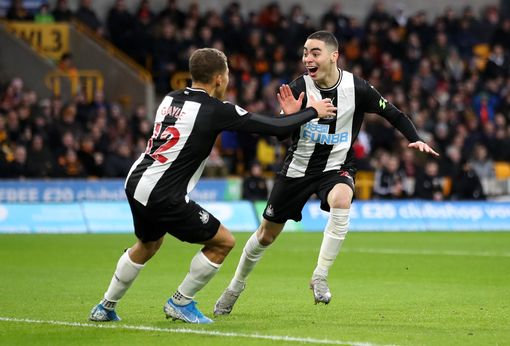 Miguel Almiron of Newcastle United celebrates with teammate Dwight Gayle after scoring his team's first goal during the Premier League match between Wolverhampton Wanderers and Newcastle United