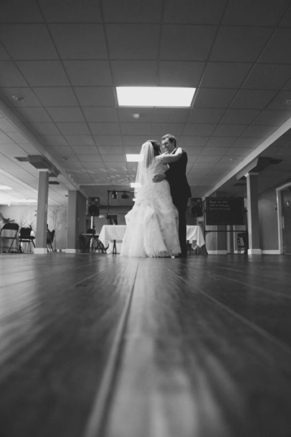 Black and white photo of a bride and groom dancing