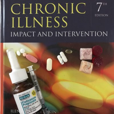 a photo of my daily pills (four gummies, three capsules, five pills, a nasal spray vial, and a syringe) against the cover of a book called 'Chronic Illness: Impact and Intervention' (7th edition)