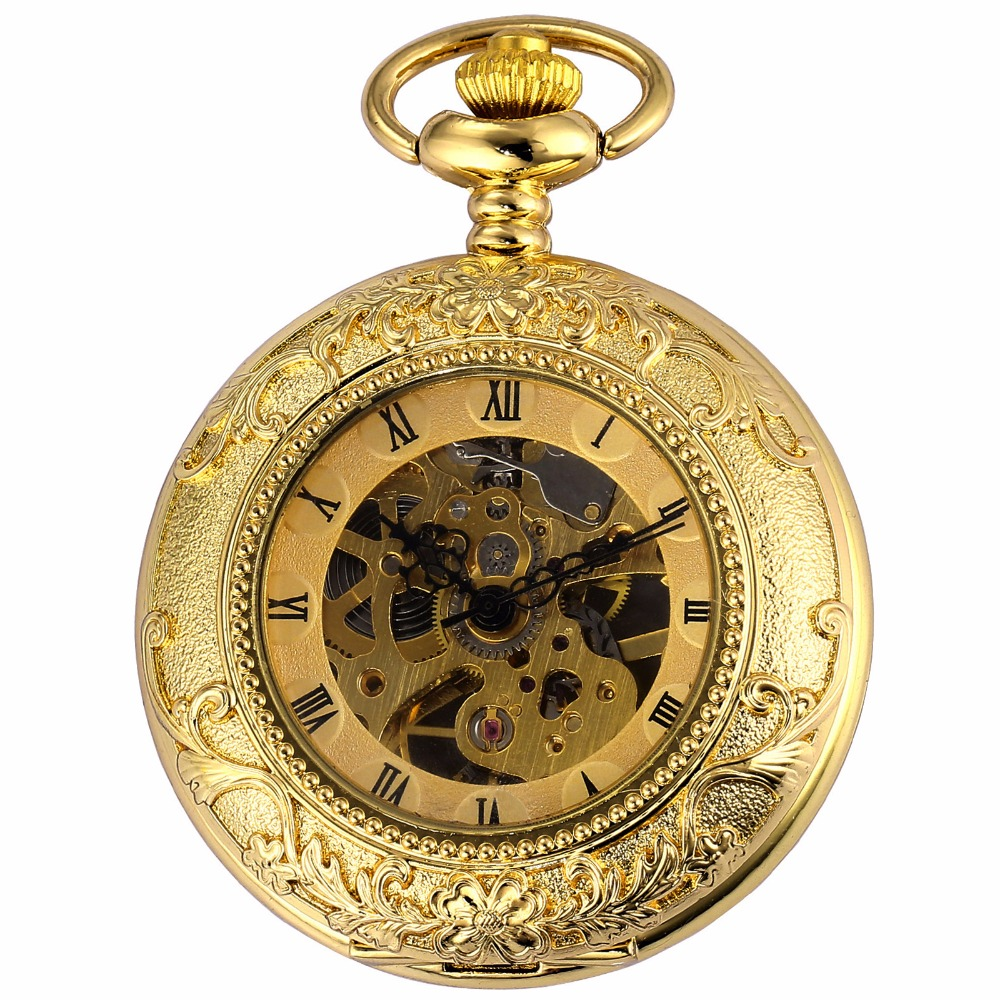 close-up of gold pocket watch with skeleton design