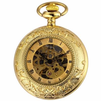 close-up of gold pocket watch with skeleton design
