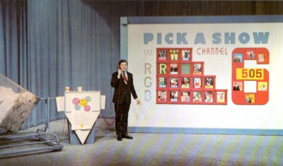 David Allan in front of the giant Pick-A-Show game board.  Image from The Best of Pick-A-Show, Scooter Records, 1972.
