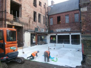 Damp course being laid for the old building extension.