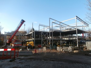 For once, the steelwork is framed by a bright blue sky.