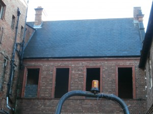 The windows of Room 9 are starting to be bricked up.