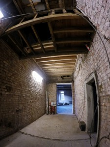 The main corridor looking towards the old Staff Room as it looks now. The door to Room 2 is still visible to the right, but the irregular stairwell landings have now been levelled out.
