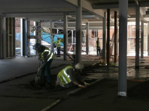 The concrete floor of the new-build being levelled.