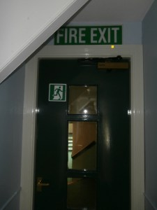 The dark, forest green fire door on the top corridor.