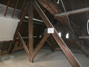 Unlikely to be the very first one, but original exposed roof couples in the north wing attic