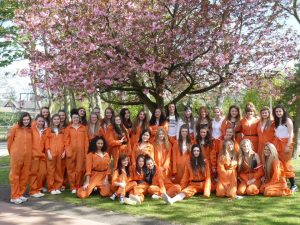 Year 11 Leavers of 2013 all pose under the cherry tree.