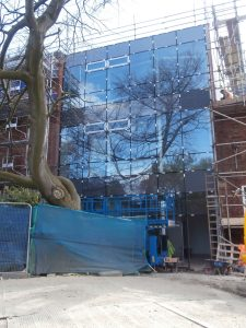 The glass-front of the new extension is now complete.