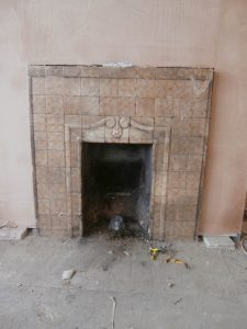 An alabaster tiled fireplace has been opened up and incorporated into the new design.