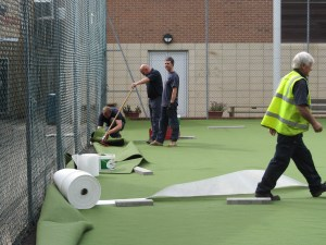 All weather astro turf being laid in June 2011.