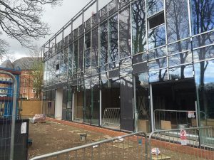 The windowed west face of the new build (Giuseppe.cam).