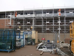 It's now the Sports Hall's turn to be cloaked in scaffold.