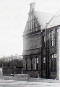 The coal shute can just be seen at the base of this 1900 photo of the back of the north gable of Newcastle High School (Centenary Book).