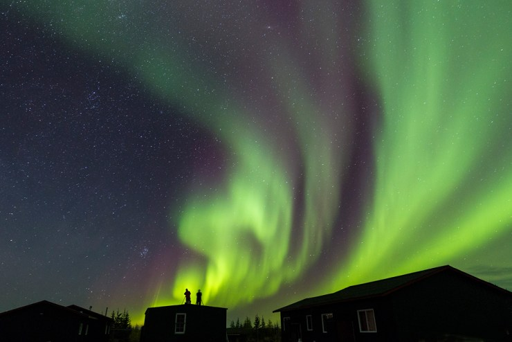 Photographing the northern lights at Nanuk Polar Bear Lodge. Rod Kuo photo.