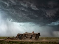 Old house in a storm by Robert Postma.
