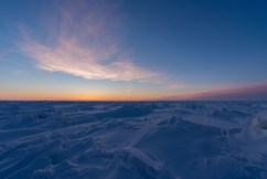 Flashes of orange over ice at Nanuk Polar Bear Lodge.