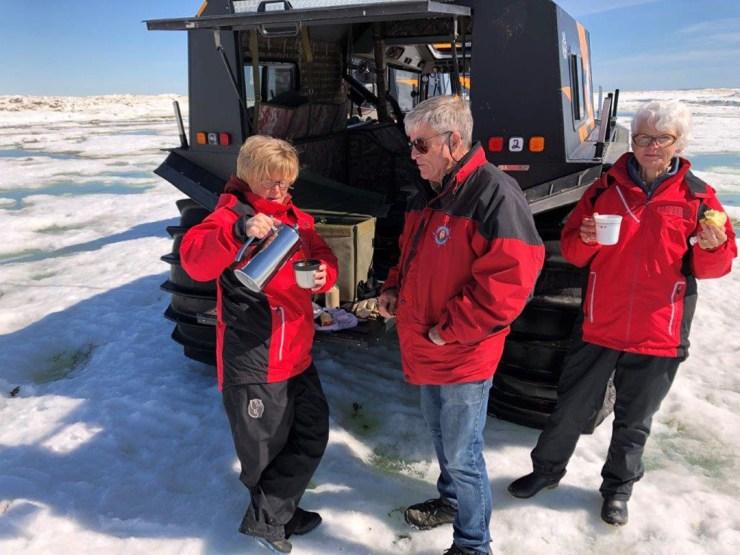 Jeanne Reimer, Doug and Helen Webber enjoy coffee and Baileys on the edge of the ice floe.