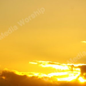 Sun behind the clouds Christian Worship Background. High quality worship images for use to spread the Gospel and enhance the worship experience.