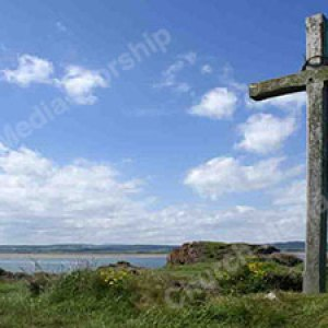 Wood Cross and thornes on hill overlooking ocean Christian Worship Background. High quality worship images for use to spread the Gospel and worship