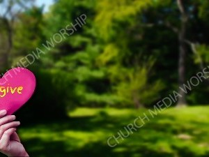Child holding paper heart - Forgive Christian Worship Background. High quality worship images for use to spread the Gospel and enhance the worship experience.