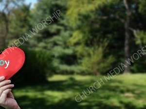 Child holding paper heart - Joy Christian Worship Background. High quality worship images for use to spread the Gospel and enhance the worship experience.