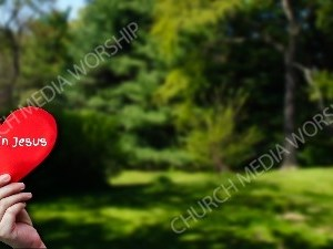 Child holding paper heart - Trust in Jesus Christian Worship Background. High quality worship images for use to spread the Gospel and enhance the worship experience.