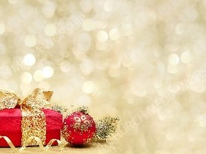 Christmas Red Gift and Ornaments on golden matte Christian Worship Background. High quality worship images for use to spread the Gospel and enhance the worship experience.