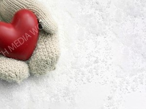 Gloves holding a heart over the snow Christian Worship Background. High quality worship images for use to spread the Gospel and enhance the worship experience.