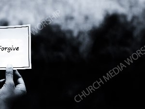Hand holding note BandW - Forgive Christian Worship Background. High quality worship images for use to spread the Gospel and enhance the worship experience.