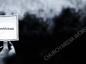 Hand holding note BandW - Thankfulness Christian Worship Background. High quality worship images for use to spread the Gospel and enhance the worship experience.