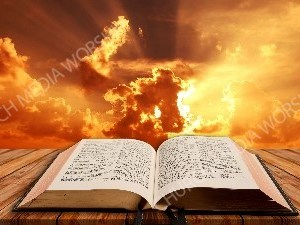Open Bible on table - Sunset 2 Christian Worship Background. High quality worship images for use to spread the Gospel and enhance the worship experience.